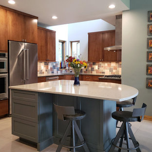 Mid-sized modern u-shaped eat-in kitchen in Other with an undermount sink, flat-panel cabinets, medium wood cabinets, quartz benchtops, multi-coloured splashback, slate splashback, stainless steel appliances, concrete floors, with island, grey floor and grey benchtop.