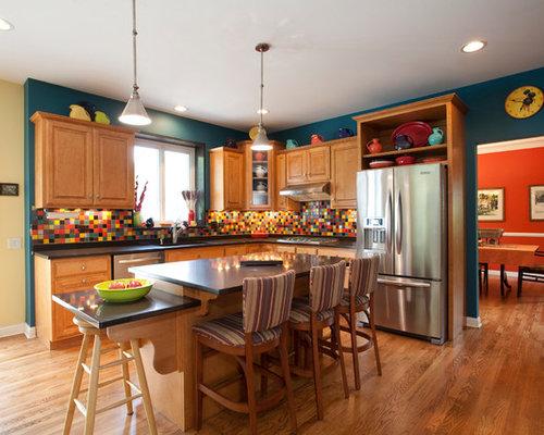 Large elegant l-shaped medium tone wood floor and brown floor eat-in kitchen