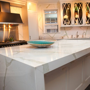 Trendy kitchen photo in Other with quartz countertops
