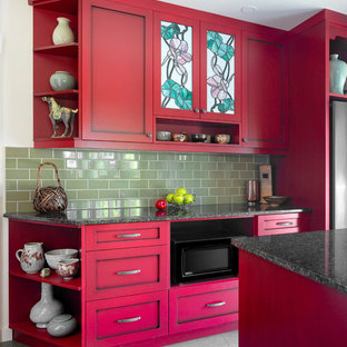 Mid-sized arts and crafts u-shaped separate kitchen in Other with shaker cabinets, red cabinets, quartz benchtops, green splashback, ceramic splashback, stainless steel appliances, with island, black benchtop, an undermount sink, ceramic floors and grey floor.