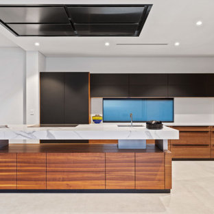 Design ideas for a contemporary kitchen in Perth with an undermount sink, flat-panel cabinets, black cabinets, with island, beige floor and white benchtop.