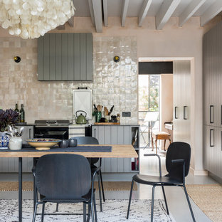 Inspiration for an industrial kitchen/diner in London with grey cabinets, limestone worktops, concrete flooring and grey floors.