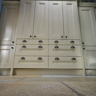 Large victorian l-shaped separate kitchen in Other with a farmhouse sink, beaded inset cabinets, beige cabinets, black splashback, slate splashback, coloured appliances, slate floors and beige floor.