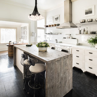 Mid-sized transitional kitchen ideas - Kitchen - mid-sized transitional single-wall dark wood floor kitchen idea in San Francisco with an undermount sink, an island, flat-panel cabinets, light wood cabinets, marble countertops, white backsplash, ceramic backsplash and stainless steel appliances