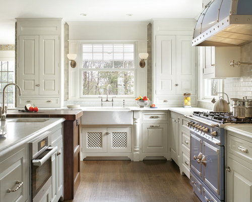 victorian lshaped kitchen idea in new york with a farmhouse sink raised