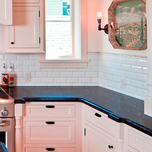 Design ideas for a mid-sized traditional l-shaped separate kitchen in Vancouver with a farmhouse sink, beaded inset cabinets, beige cabinets, quartz benchtops, multi-coloured splashback, subway tile splashback, stainless steel appliances, ceramic floors and with island.