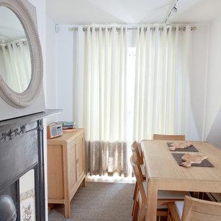 ロンドンの小さいインダストリアルスタイルのおしゃれなキッチン (シングルシンク、シェーカースタイル扉のキャビネット、ベージュのキャビネット、木材カウンター、ベージュキッチンパネル、セラミックタイルのキッチンパネル、シルバーの調理設備の、淡色無垢フローリング、アイランドなし) の写真