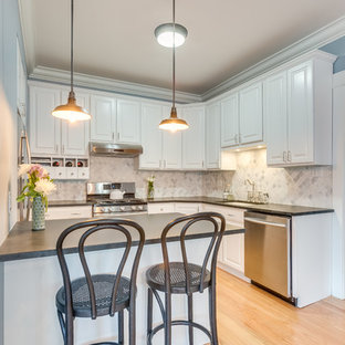 Design ideas for a mid-sized traditional u-shaped eat-in kitchen in Chicago with an undermount sink, raised-panel cabinets, white cabinets, zinc benchtops, multi-coloured splashback, porcelain splashback, stainless steel appliances, light hardwood floors and a peninsula.