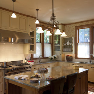 This is an example of a traditional kitchen in Boston with beaded inset cabinets, stainless steel appliances, subway tile splashback and granite benchtops.