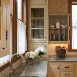 Victorian kitchen in Boston with beaded inset cabinets, subway tile splashback, a single-bowl sink, granite benchtops and beige cabinets.