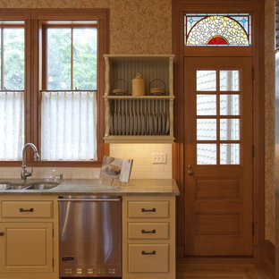 This is an example of a traditional kitchen in Boston with stainless steel appliances.
