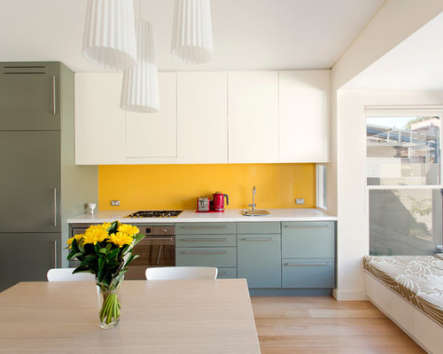 small contemporary eat in kitchen designs example of a small trendy single wall - Glass Sheet Kitchen Design
