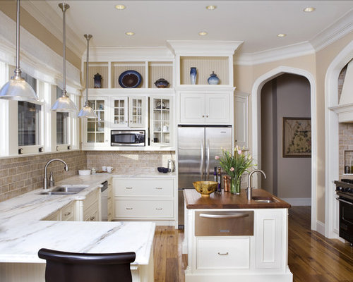 Attractive Inspiration For A Large Timeless U Shaped Enclosed Kitchen Remodel In New  York With Glass Part 10