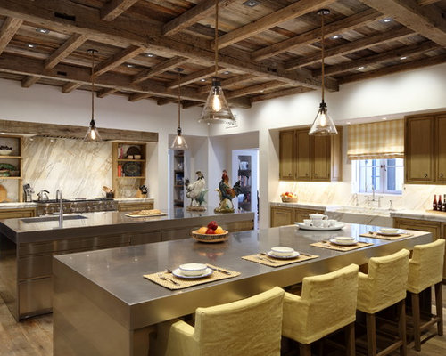 Example Of A Tuscan Enclosed Kitchen Design In Los Angeles With A Farmhouse Sink Light