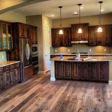 Rustic Kitchen by Vintage Fine Homes Inc