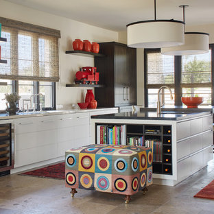 Mid-sized modern open concept kitchen ideas - Example of a mid-sized minimalist galley concrete floor and gray floor open concept kitchen design in Phoenix with an undermount sink, flat-panel cabinets, dark wood cabinets, beige backsplash, paneled appliances, an island, marble countertops and white countertops