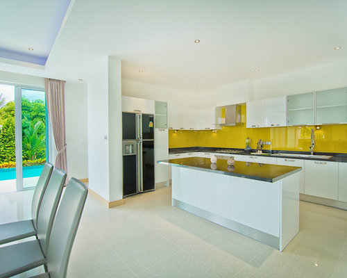 kitchen design ideas renovations photos with yellow splashback and