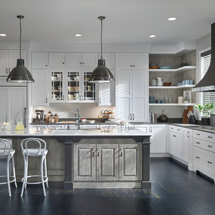 Huge transitional open concept kitchen ideas - Inspiration for a huge transitional l-shaped open concept kitchen remodel in Minneapolis with flat-panel cabinets, white cabinets, quartz countertops, white backsplash, paneled appliances and an island