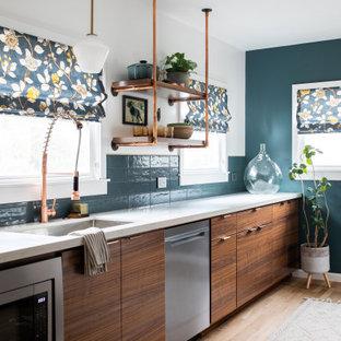 Midcentury single-wall kitchen in Sacramento with an undermount sink, flat-panel cabinets, medium wood cabinets, blue splashback, stainless steel appliances, medium hardwood floors, no island, brown floor and white benchtop.