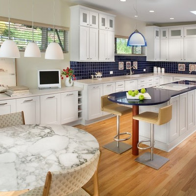 Eat-in kitchen - modern l-shaped eat-in kitchen idea in DC Metro with shaker cabinets, white cabinets, blue backsplash and blue countertops