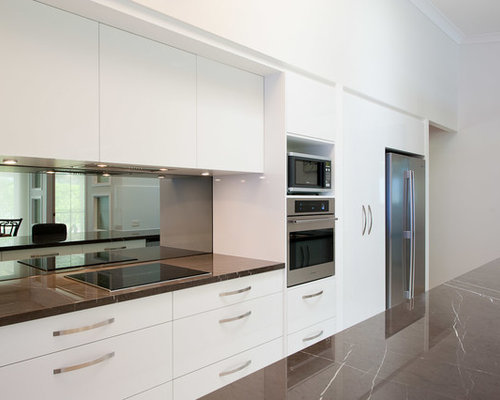 Mid sized contemporary galley open plan kitchen in hobart with an undermount sink flat