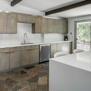 Design ideas for a large midcentury l-shaped open plan kitchen in Other with an undermount sink, flat-panel cabinets, distressed cabinets, quartz benchtops, white splashback, stone slab splashback, stainless steel appliances, slate floors, a peninsula, multi-coloured floor and white benchtop.