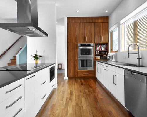 Example Of A Mid Sized Minimalist Galley Medium Tone Wood Floor And Brown  Floor Open