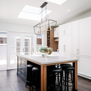Inspiration for a large transitional galley eat-in kitchen in Hobart with a farmhouse sink, shaker cabinets, white cabinets, quartz benchtops, dark hardwood floors, with island, brown floor, white benchtop and panelled appliances.
