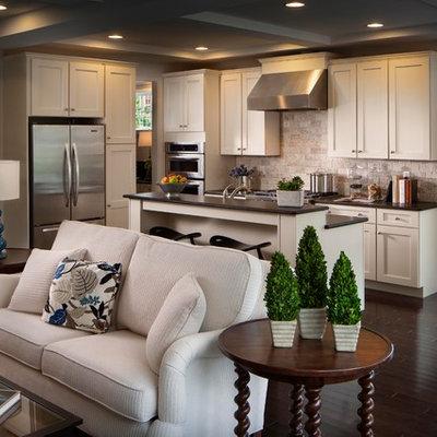 Elegant l-shaped open concept kitchen photo in Other with shaker cabinets, beige cabinets, beige backsplash and limestone backsplash