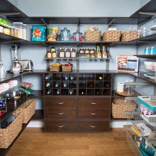 This is an example of a large contemporary u-shaped kitchen pantry in Detroit with brown cabinets.