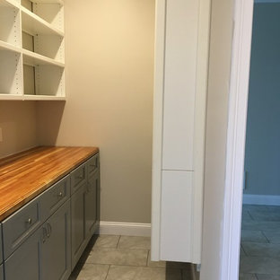 Large traditional kitchen pantry remodeling - Example of a large classic single-wall ceramic floor and gray floor kitchen pantry design in Boston with shaker cabinets, blue cabinets and wood countertops