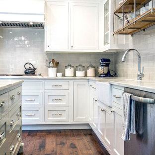 Photo of a mid-sized modern galley separate kitchen in Sydney with a drop-in sink, louvered cabinets, grey cabinets, laminate benchtops, white splashback, porcelain splashback, stainless steel appliances, porcelain floors and with island.