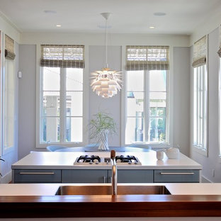 Modern kitchen inspiration - Example of a minimalist kitchen design in Jacksonville with blue cabinets and a single-bowl sink