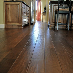 "Walnut Birch 6"" Wide - Walnut Birch hardwood flooring combines the popular birch grain with a classic walnut stain that has made it one of our most versatile and timeless products. A mix of deep mocha and warm chocolate browns makes our Walnut Birch a favorite for virtualy any living space."