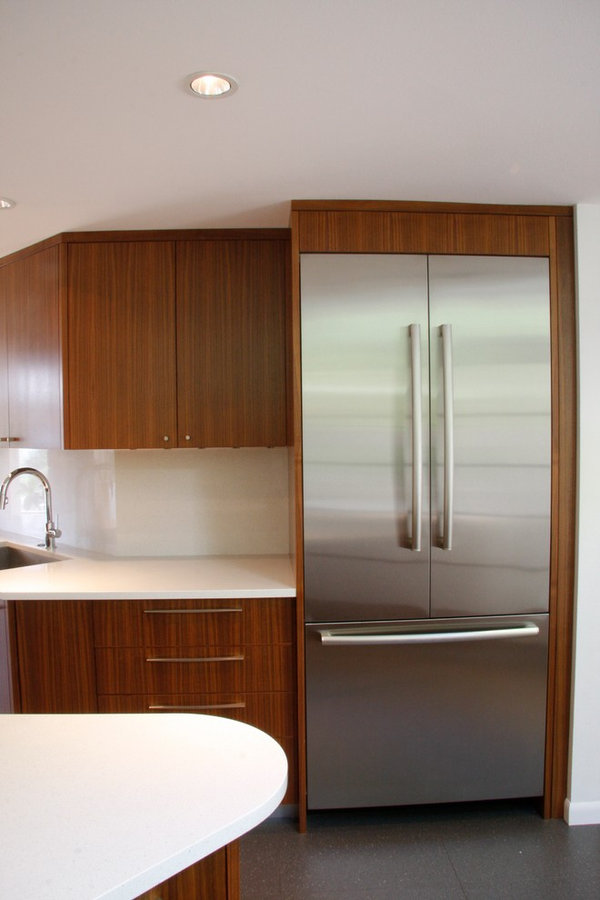 Walnut cabinetry and Bosch fridge