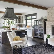 Zinc Range Hood and a Limestone Fireplace Create a Timeless Look