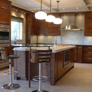 Inspiration for a contemporary u-shaped kitchen in Indianapolis with dark wood cabinets, white splashback and recessed-panel cabinets.