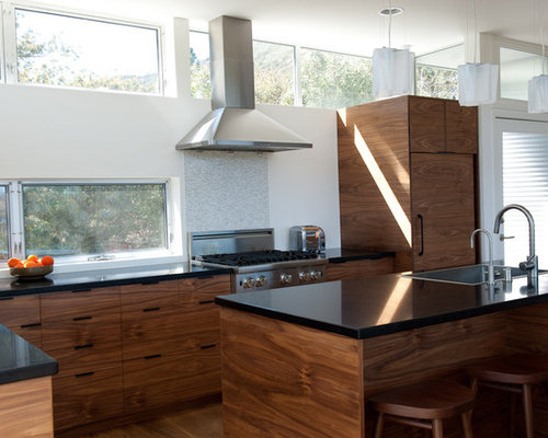 ... , shaker cabinets, dark wood cabinets and solid surface countertops