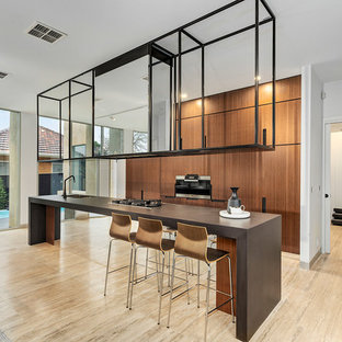 Inspiration for a large contemporary galley eat-in kitchen in Melbourne with an undermount sink, medium wood cabinets, travertine floors, with island, brown benchtop, flat-panel cabinets and beige floor.