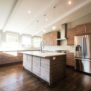 Large modern eat-in kitchen ideas - Large minimalist u-shaped dark wood floor eat-in kitchen photo in Other with a single-bowl sink, flat-panel cabinets, quartz countertops, white backsplash, mosaic tile backsplash, stainless steel appliances, an island and dark wood cabinets