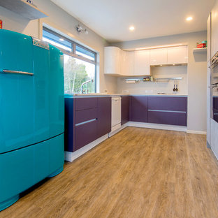 Mid-sized midcentury u-shaped kitchen pantry in Hamilton with a double-bowl sink, flat-panel cabinets, purple cabinets, laminate benchtops, vinyl floors and no island.