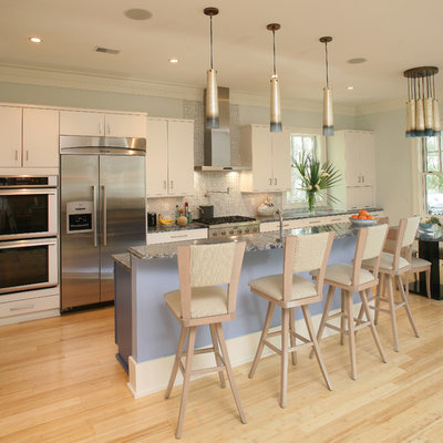 Inspiration for a transitional galley eat-in kitchen remodel in Charleston with flat-panel cabinets, white cabinets, stainless steel appliances and white backsplash
