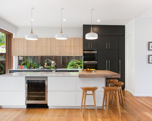 kitchen design ideas renovations photos with black cabinets and flat panel cabinets. Black Bedroom Furniture Sets. Home Design Ideas