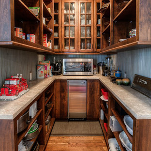 Traditional u-shaped kitchen pantry in Kansas City with open cabinets, dark wood cabinets, stainless steel appliances, medium hardwood floors and no island.