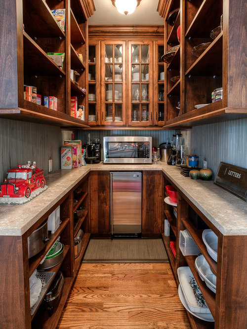 kitchen pantry with stainless steel appliances and dark