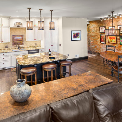 Inspiration for a mid-sized rustic l-shaped dark wood floor open concept kitchen remodel in Other with white cabinets, granite countertops, beige backsplash, stainless steel appliances, an undermount sink, shaker cabinets, brick backsplash and an island