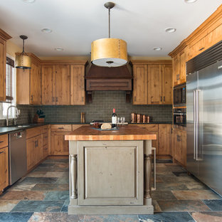 Mid-sized rustic eat-in kitchen inspiration - Inspiration for a mid-sized rustic u-shaped porcelain floor and multicolored floor eat-in kitchen remodel in Chicago with an undermount sink, shaker cabinets, light wood cabinets, granite countertops, gray backsplash, stainless steel appliances and slate backsplash