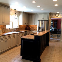 Warm and Welcoming - This kitchen features our semi-custom line. Perimeter finish is Tinderbox paint. Island is Espresso stain on Maple.