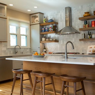 Large transitional eat-in kitchen ideas - Example of a large transitional l-shaped medium tone wood floor and orange floor eat-in kitchen design in Raleigh with shaker cabinets, gray backsplash, an island, a single-bowl sink, gray cabinets, quartz countertops, marble backsplash, stainless steel appliances and white countertops
