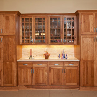 Inspiration for a large country l-shaped open plan kitchen in Minneapolis with a double-bowl sink, flat-panel cabinets, medium wood cabinets, quartz benchtops, beige splashback, stone tile splashback, stainless steel appliances, ceramic floors and with island.